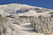 snow covered mountain and ski lift