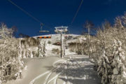 image of ski lift with snowy landscape