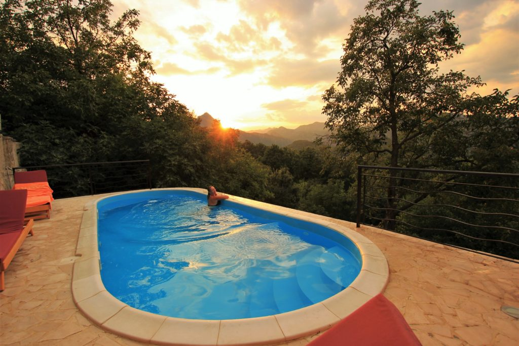 Swimming pool with a view at sunset