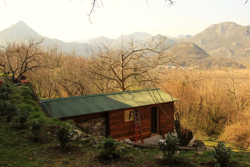 Self-constructed eco-cabin looking out over a valley