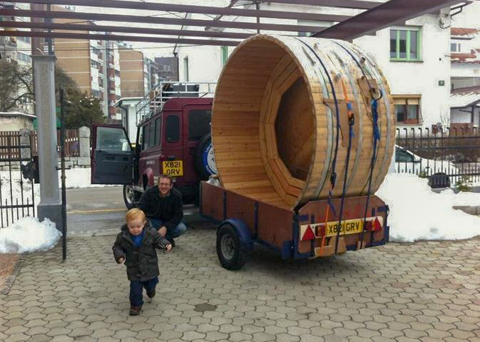 A big hot tub loaded onto a tiny trailer in transit to Montenegro